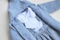 Camisa blanca de plumeti con lazo en el pecho